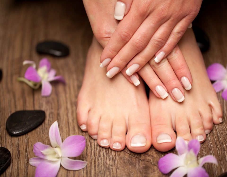 Womens Feet and Hands with flower pedals