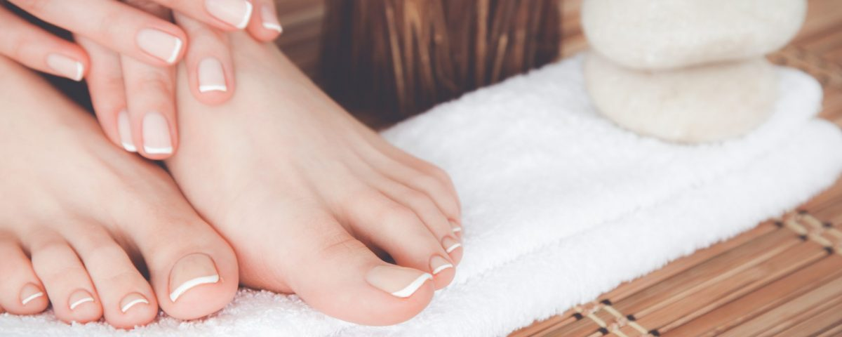 hands and feet with manicure and pedicure