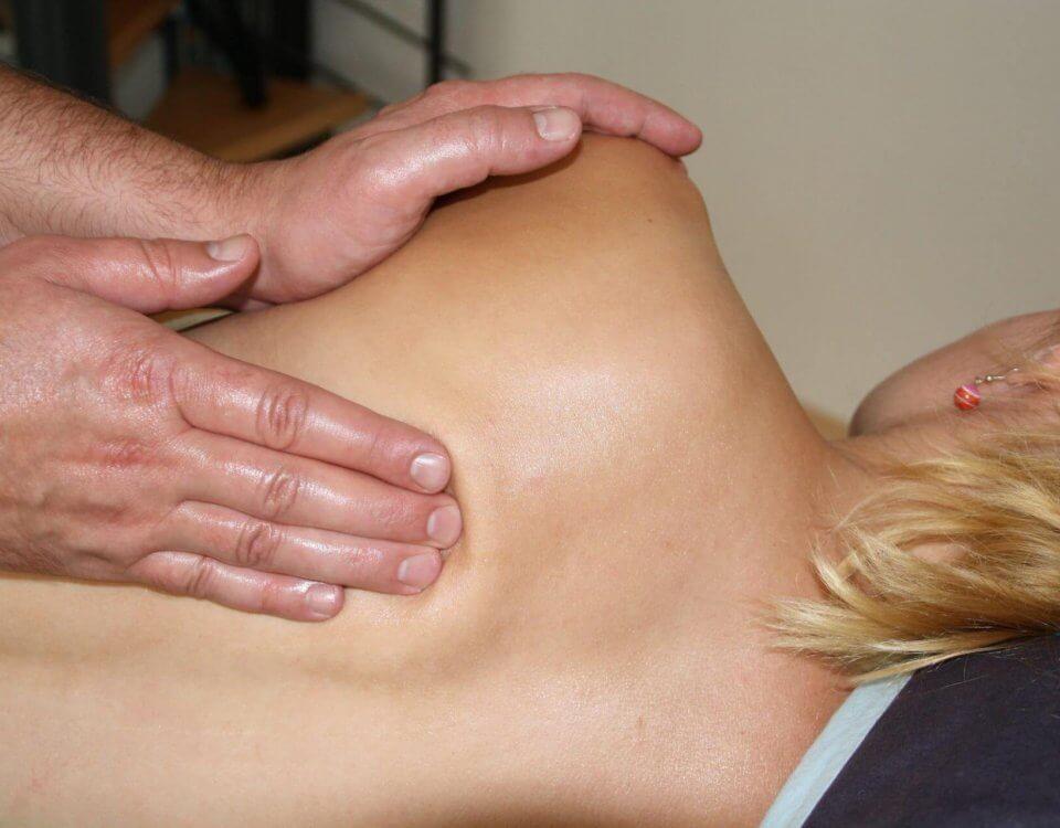 licensed massage therapist giving massage